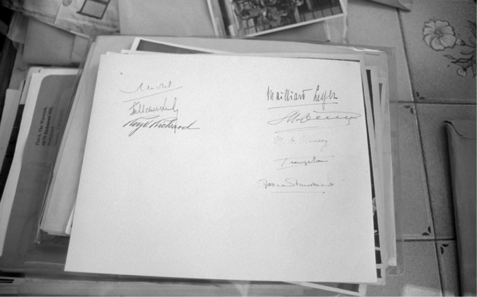 Signatures of Quadripartite Commission and their secretaries, back of photo. This must have been a souvenir of grandpa's as his signature is not included [collection family archive].